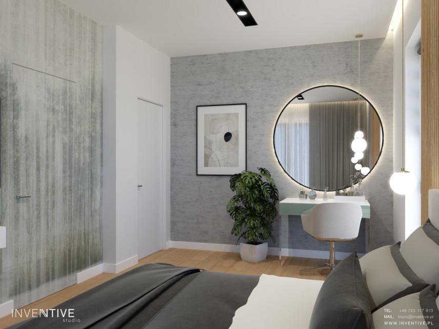 Sypialnia z dużym okrągłym lustrem