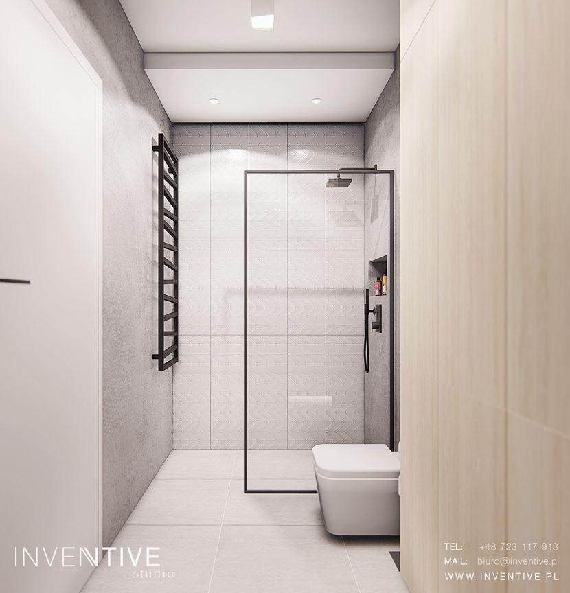 Aranżacja małej łazienki z białą muszlą klozetową
