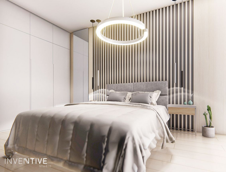 Aranżacja sypialni ze ścianą z elementami drewna