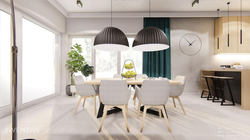 Jadalnia z drewnianym stołem i modnymi lampami wiszącymi