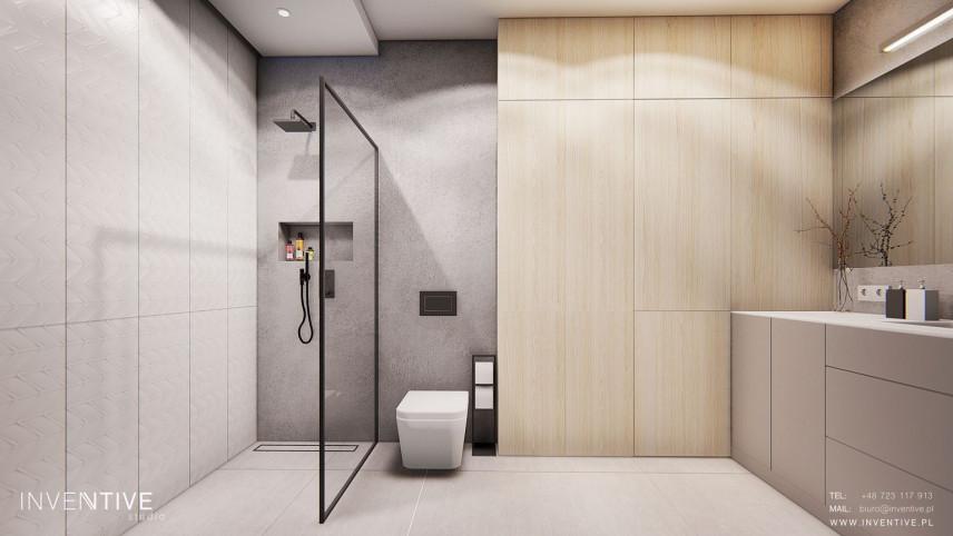 Aranżacja przestrzennej łazienki z prysznicem walk - in