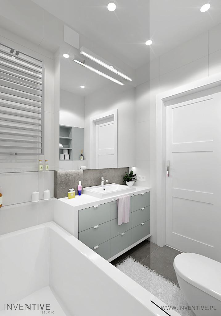 Jasna łazienka z biało-szarymi frontami