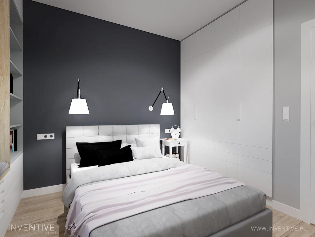 Mała sypialnia z antracytową ścianą