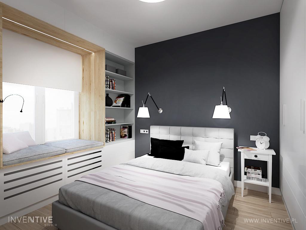 Sypialnia z wnęką okienną z poduszkami