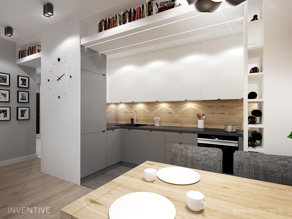 Aneks kuchenny z zegarem na ścianie