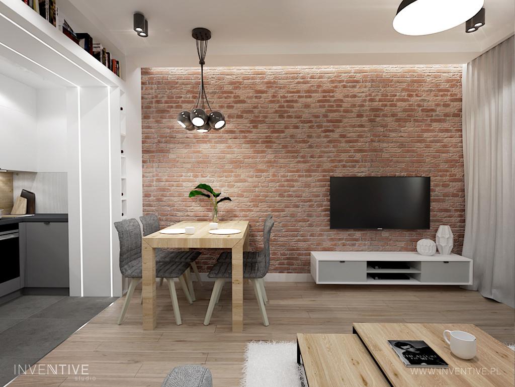 Telewizor na ścianie z rustykalnej cegły