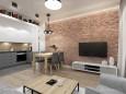 Salon w stylu skandynawskim z cegłą na ścianie