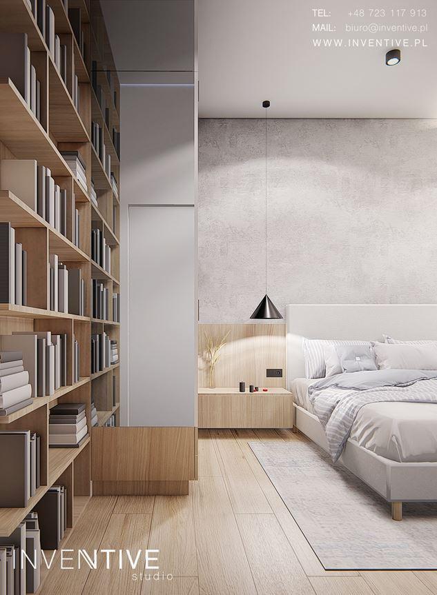 Aranżacja sypialni z dużą, drewnianą biblioteczką