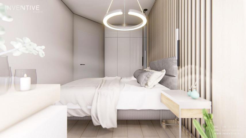 Sypialnia z okrągłą lampą wiszącą