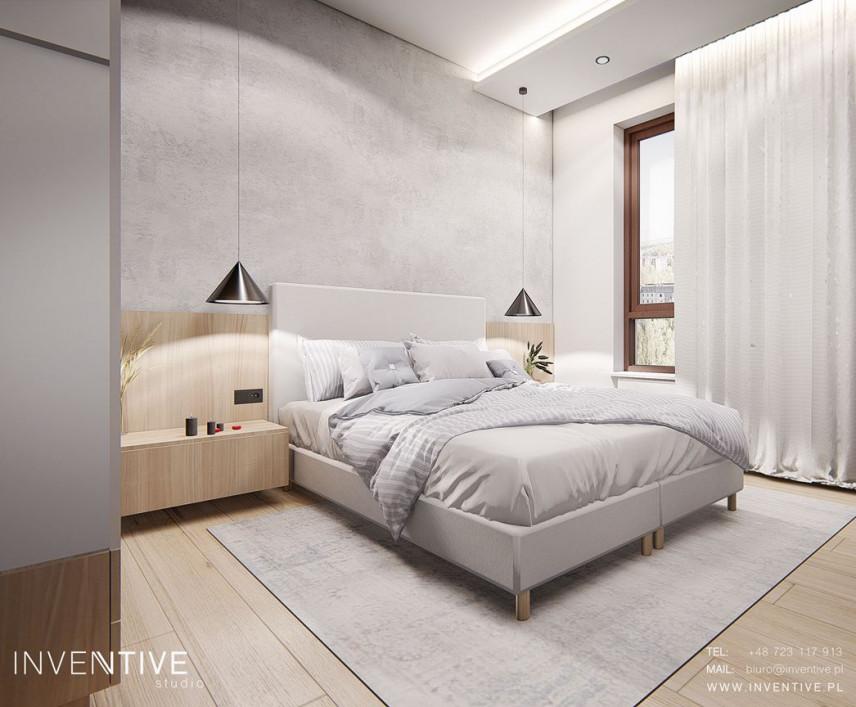 Sypialnia z drewnianymi elementami na ścianie