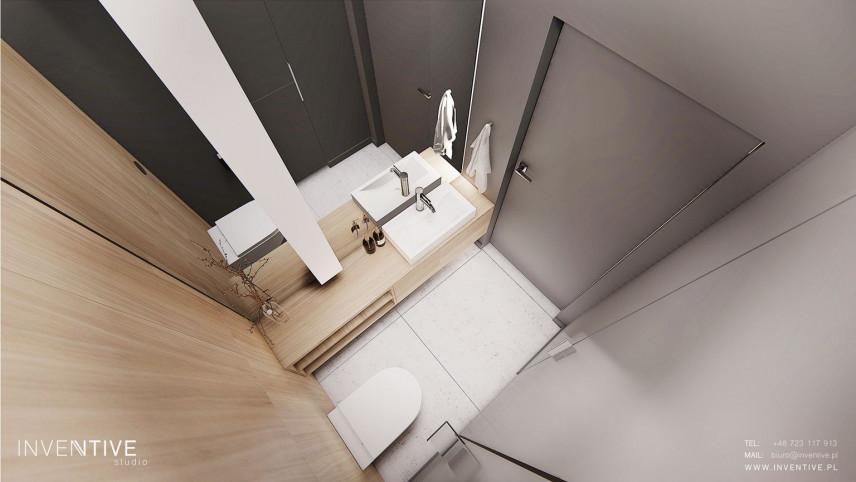 Łazienka z muszlą wiszącą i szarymi ścianami