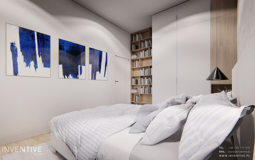 Sypialnia z modnymi obrazami na ścianie