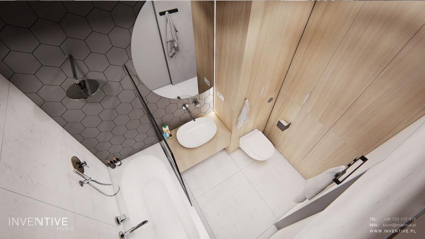 Aranżacja łazienki z wanną w zabudowie, lustrem okrągłym