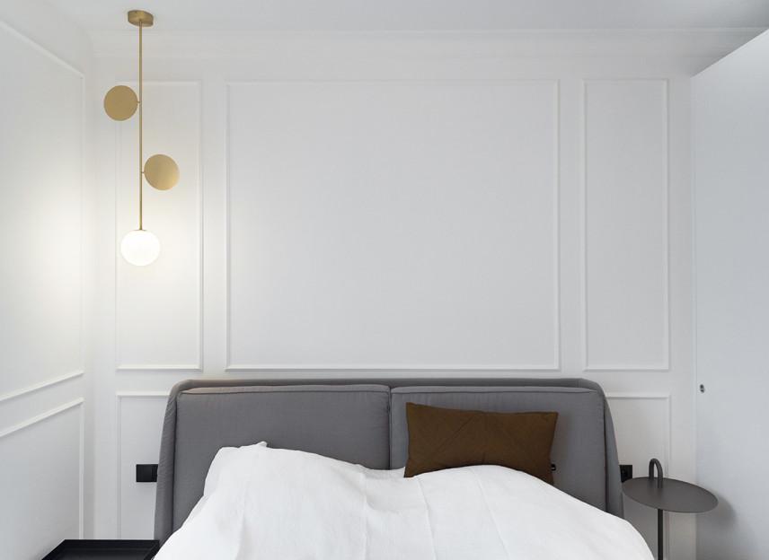 Niewielka sypialnia z tapicerowanym łóżkiem