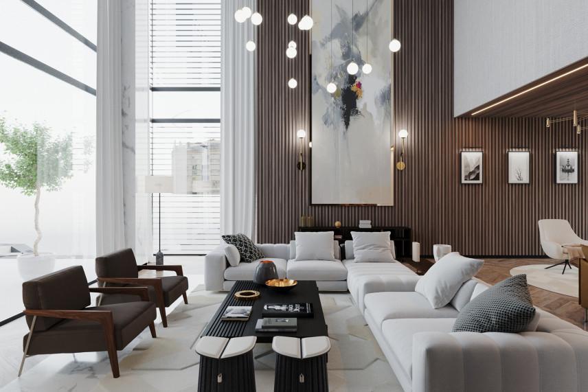 Przestrzenny salon z białymi meblami