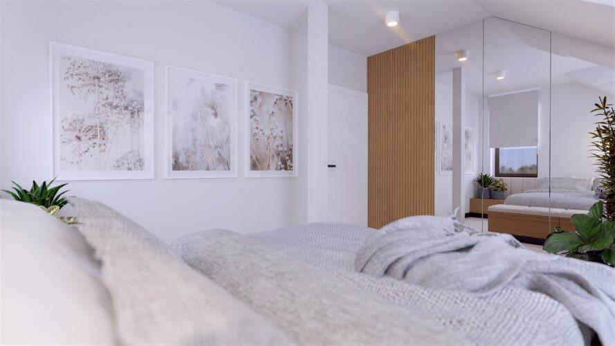 Jasna sypialnia ze ścianą z lustrami
