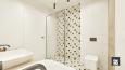 Łazienka z biało-czarnymi płytkami pod prysznicem