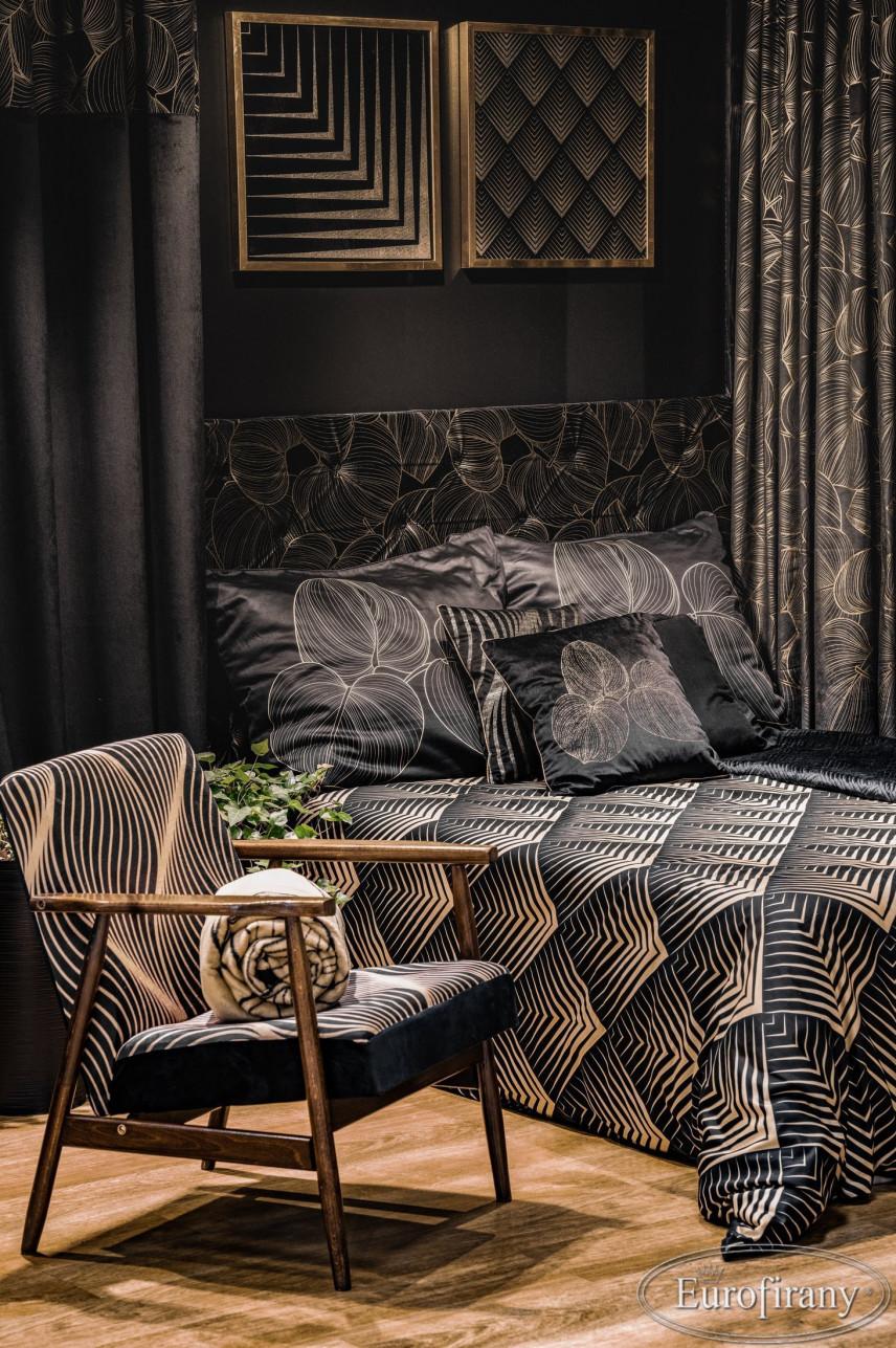 Sypialnia w kolorze czarnym z czarno-złotymi tekstyliami