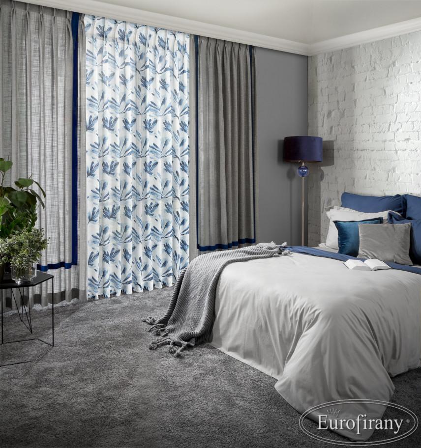 Aranżacja sypialni z białą cegłą na ścianie