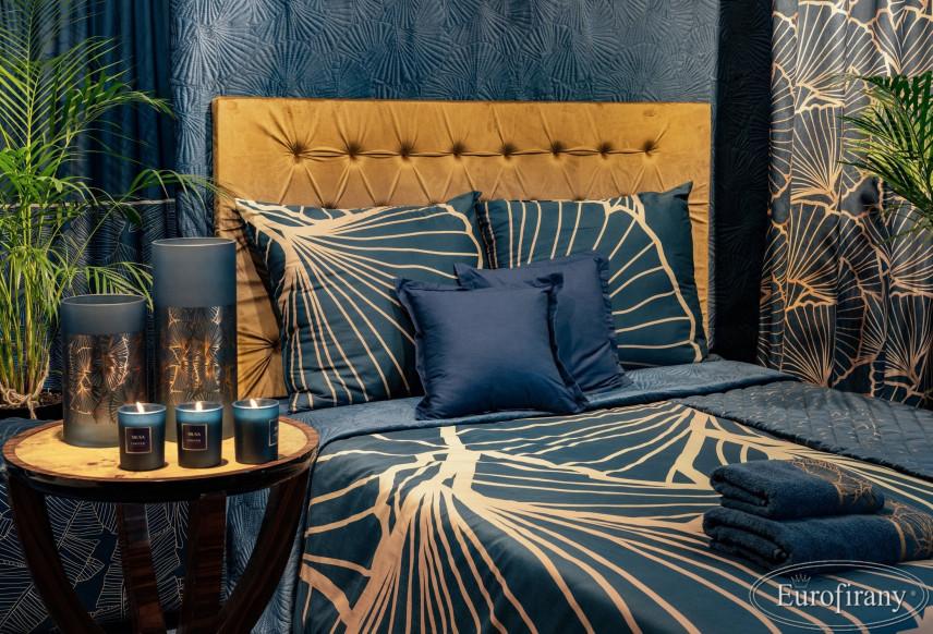 Aranżacja sypialni z brązowym zagłówkiem pikowanym