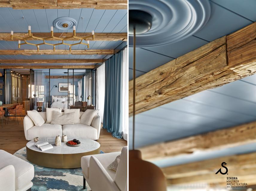 Stylowy salon z  błękitną boazerią na suficie
