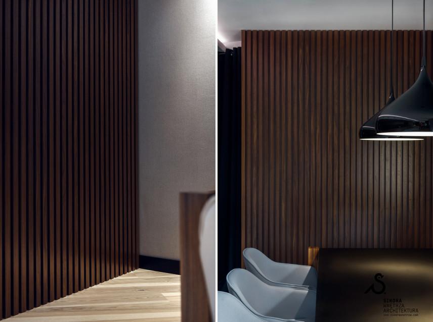Salon z elementami drewna na ścianie