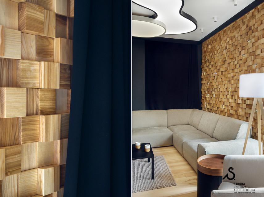 Stylowy salon z drewnianą ścianą