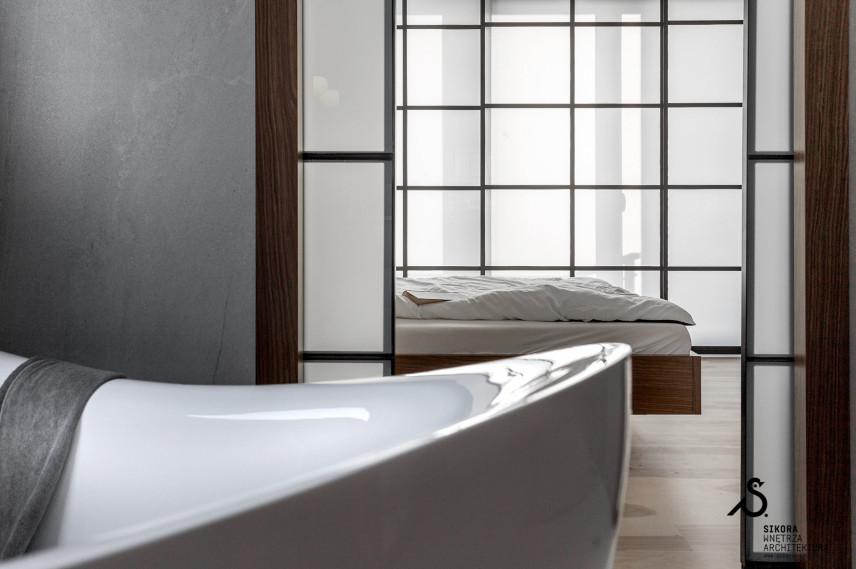 Minimalistyczna sypialnia z łazienką