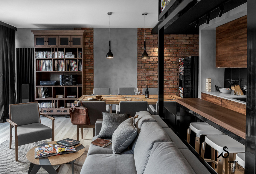 Salon z kuchnią i jadalnią w stylu loft