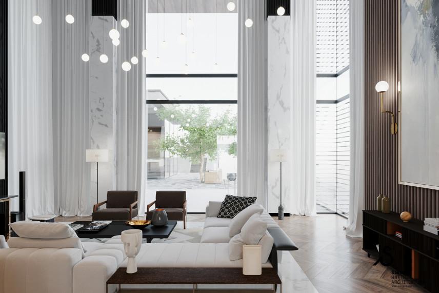 Efektowny salon z wielkimi oknami