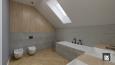 Aranżacja łazienki ze skosami i wanną w zabudowie