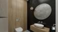 Aranżacja łazienki z białą muszlą wiszącą