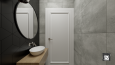 Łazienka z czarną płytką na ścianie i lustrem w stylu loft