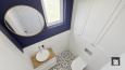 Aranżacja łazienki z biało-czarną podłogą
