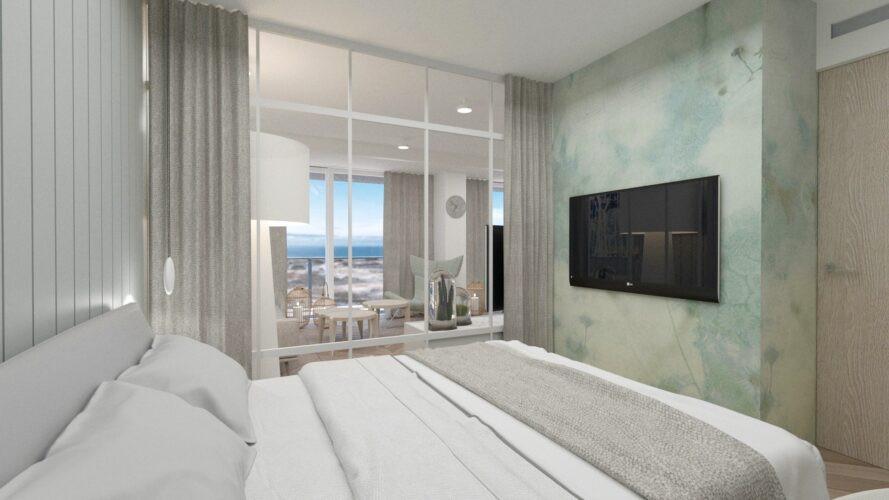 Sypialnia oddzielona od salonu szklaną witryną