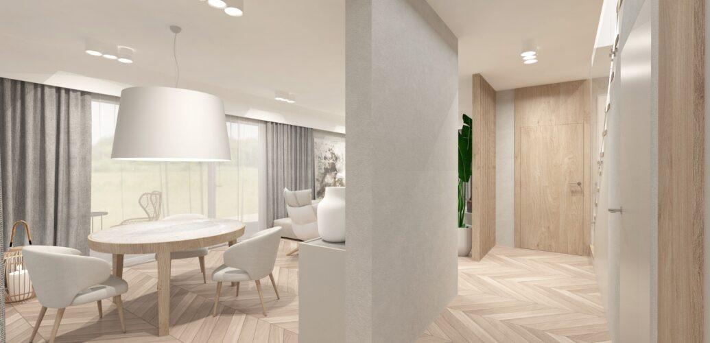 Aranżacja salonu z wielką białą lampą wiszącą