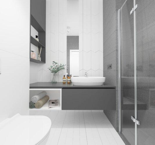 Aranżacja łazienki z szarą szafką wiszącą