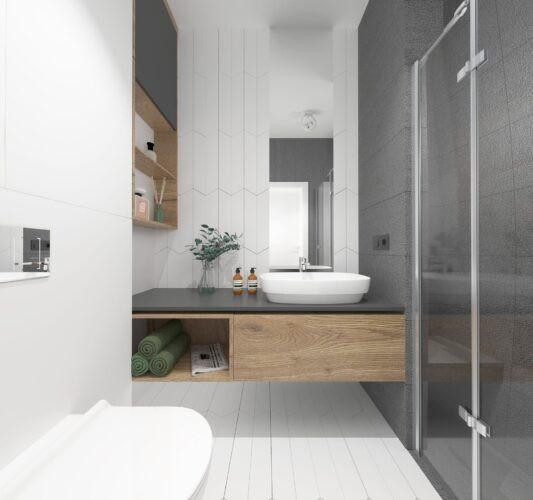 Aranżacja łazienki z drewnianą szafką