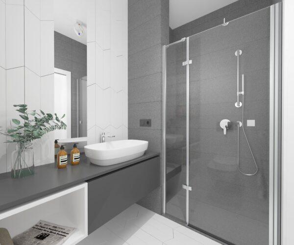 Aranżacja łazienki z białymi płytkami na ścianie i na podłodze