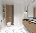 Aranżacja łazienki z obrazami na ścianie