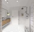 Aranżacja łazienki z białymi płytkami i prysznicem walk-in