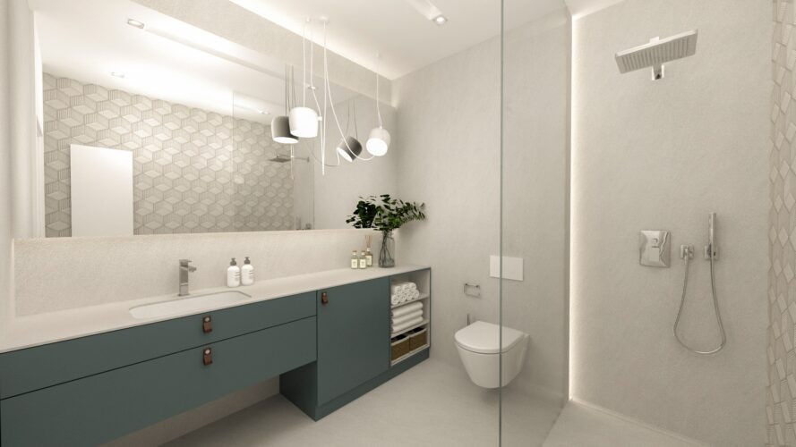 Przestrzenna łazienka z prysznicem i białą muszlą
