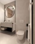 Łazienka z modnym oświetleniem kinkietowym