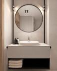 Łazienka z dużym, okrągłym lustrem