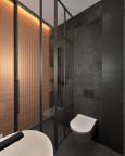 Łazienka z białą muszlą wisząca i czarnymi płytkami