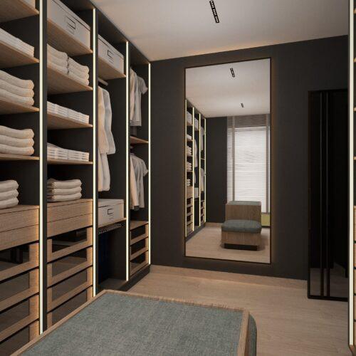 Duża garderoba z lustrem na ścianie
