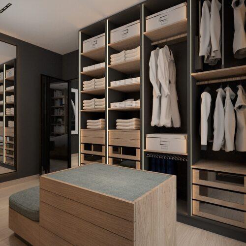 Garderoba z siedziskiem na środku i dużym lustrem