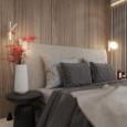 Sypialnia z drewnianymi panelami na ścianie