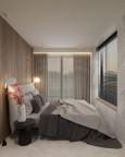 Mała, wąska sypialnia z drewnianymi panelami na ścianie