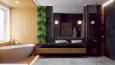 Łazienka z wanną ceramiczna owalną umieszczoną przy oknie